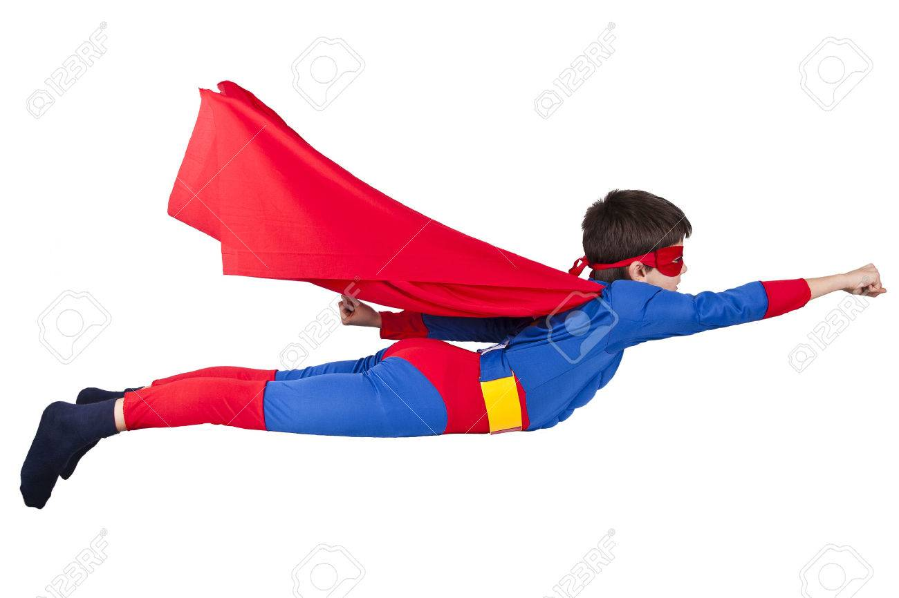 child dressed up as super hero with cape house production - 27070867