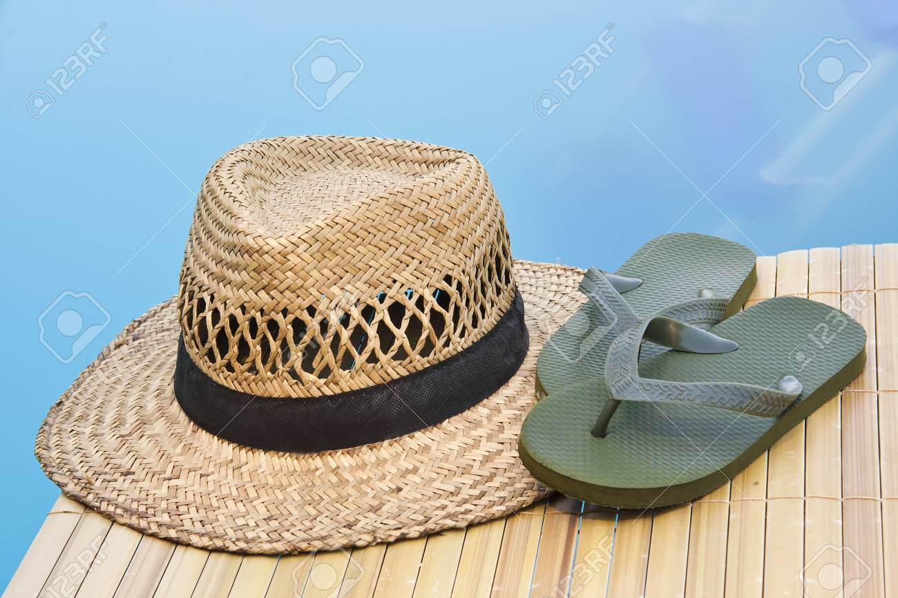 Stock Photo - Summer hat and flip flops at poolside 6796f565c110