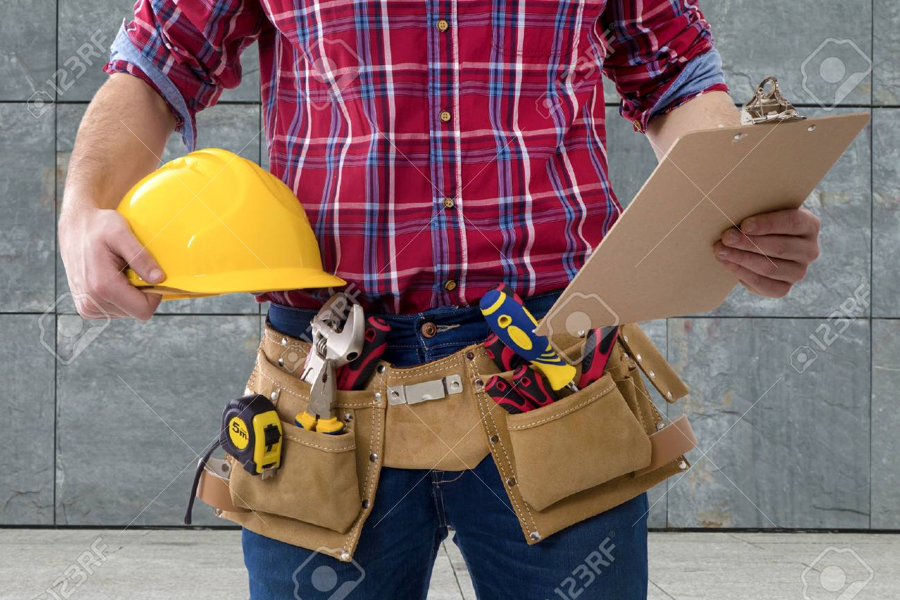 closeup of the worker of the construction with the helmet and the folder of the documents - 71757134