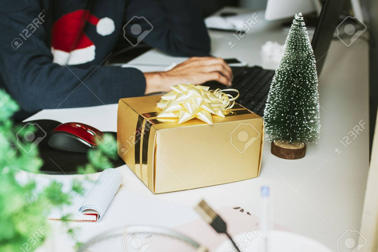 Christmas Gift Box On The Office Desk Stock Photo, Picture And ...