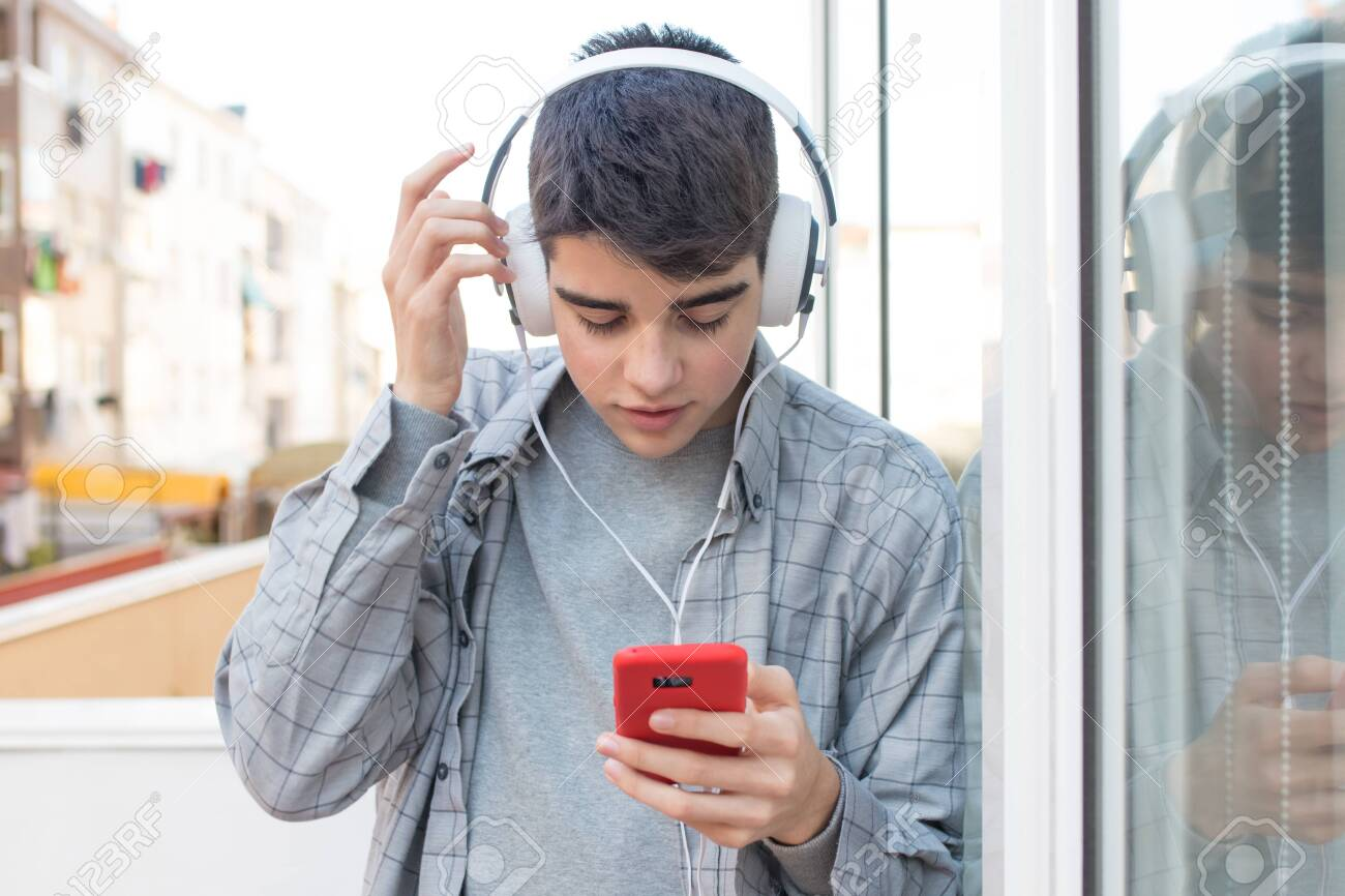 Teenage Student With Mobile Phone And Headphones Stock Photo Picture And Royalty Free Image Image 128372258