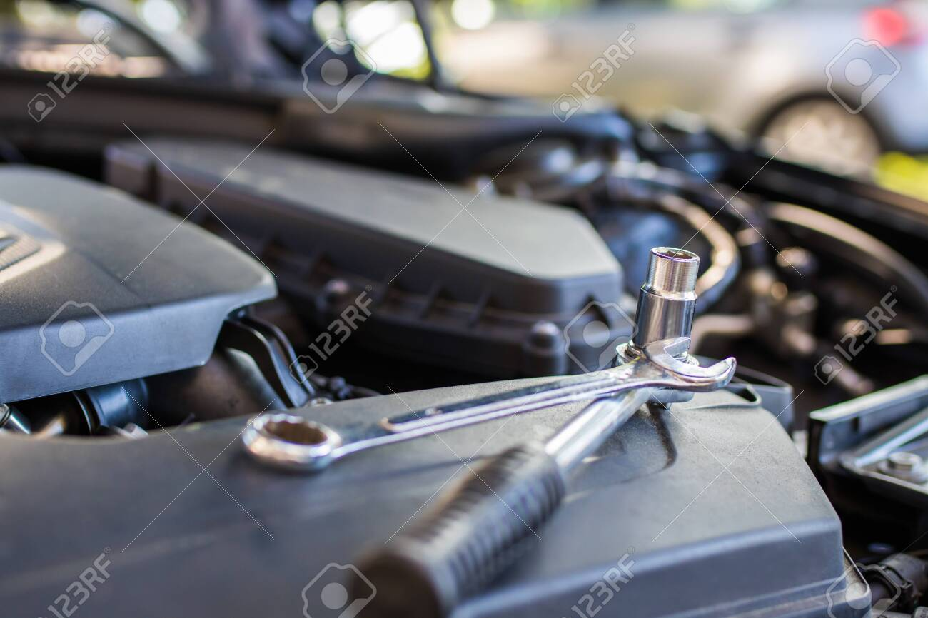 mechanical workshop, tools in the car engine - 133643009