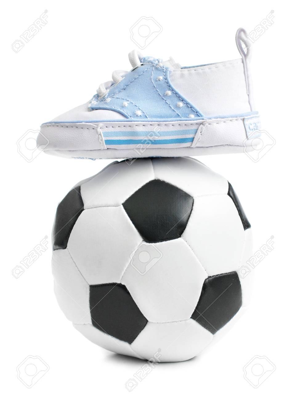 84dd452a92d48 Foto de archivo un fútbol pelota de fútbol con zapatos de bebé en blanco  jpg 1000x1300
