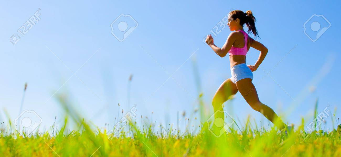 Athletic woman working out in a meadow, from a complete series of photos. - 5480579