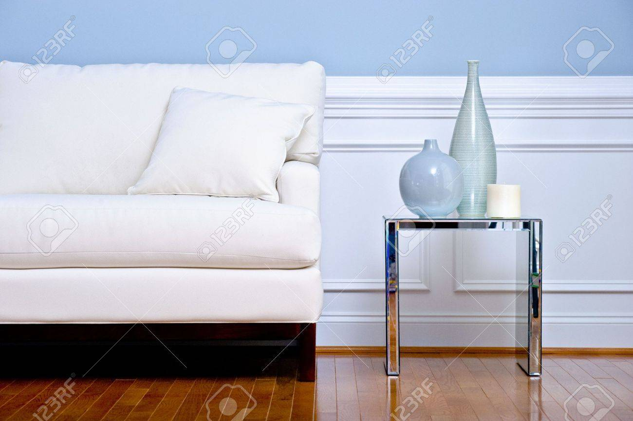 Cropped View Of White Couch And Side Table With Vases, In A Living ...
