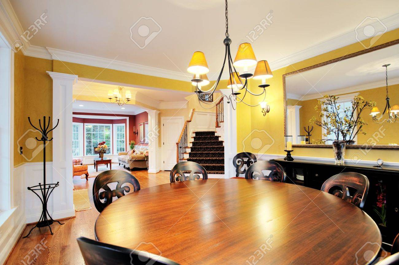 Wide Angle View Of Dining Room With Round Table And Chandelier Horizontal Format