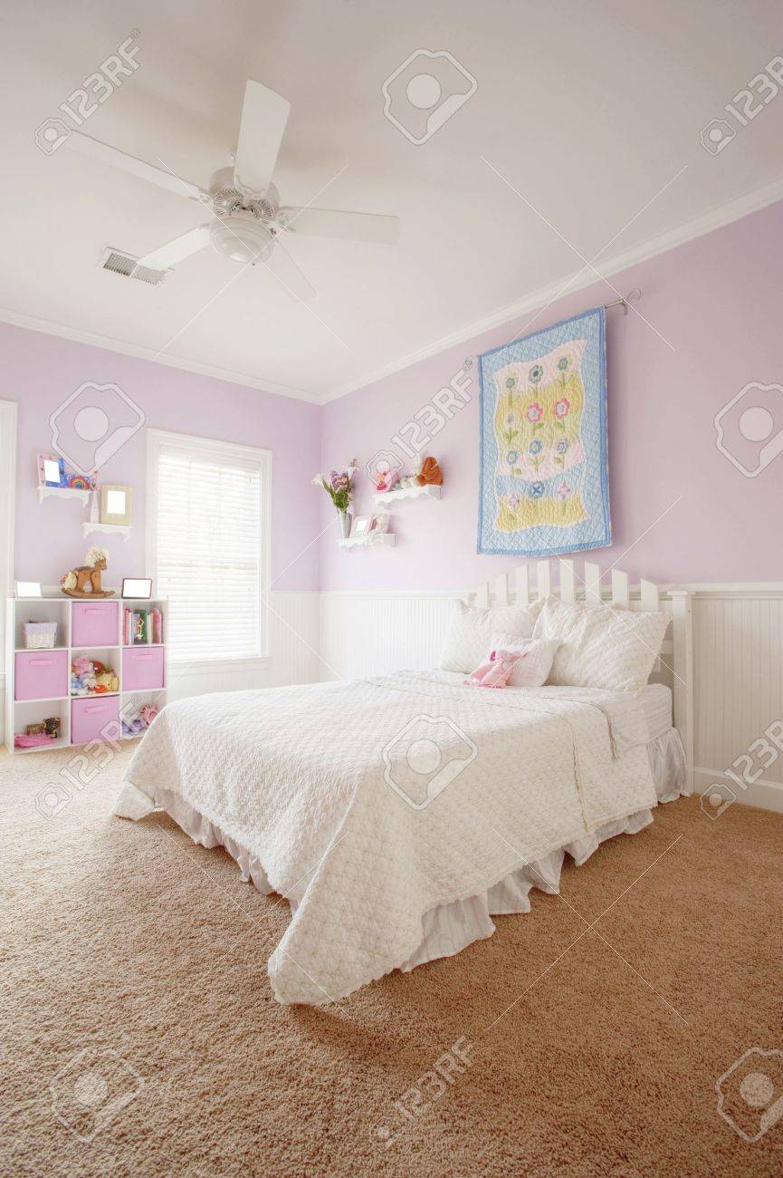 Wide angle view of a girl's bedroom. Vertical format. Stock Photo - 6249365