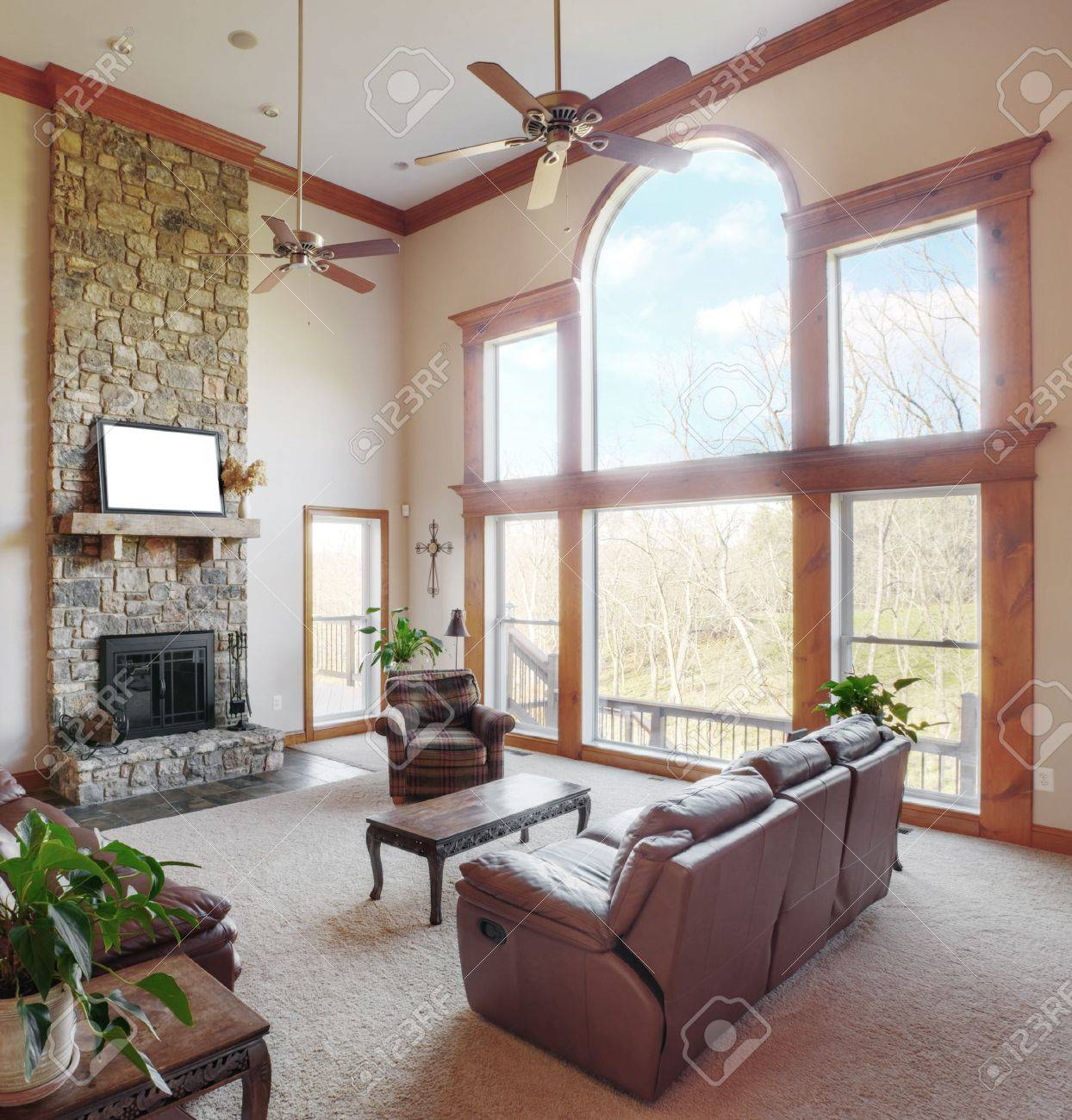 traditional living room interior with a high ceiling and large