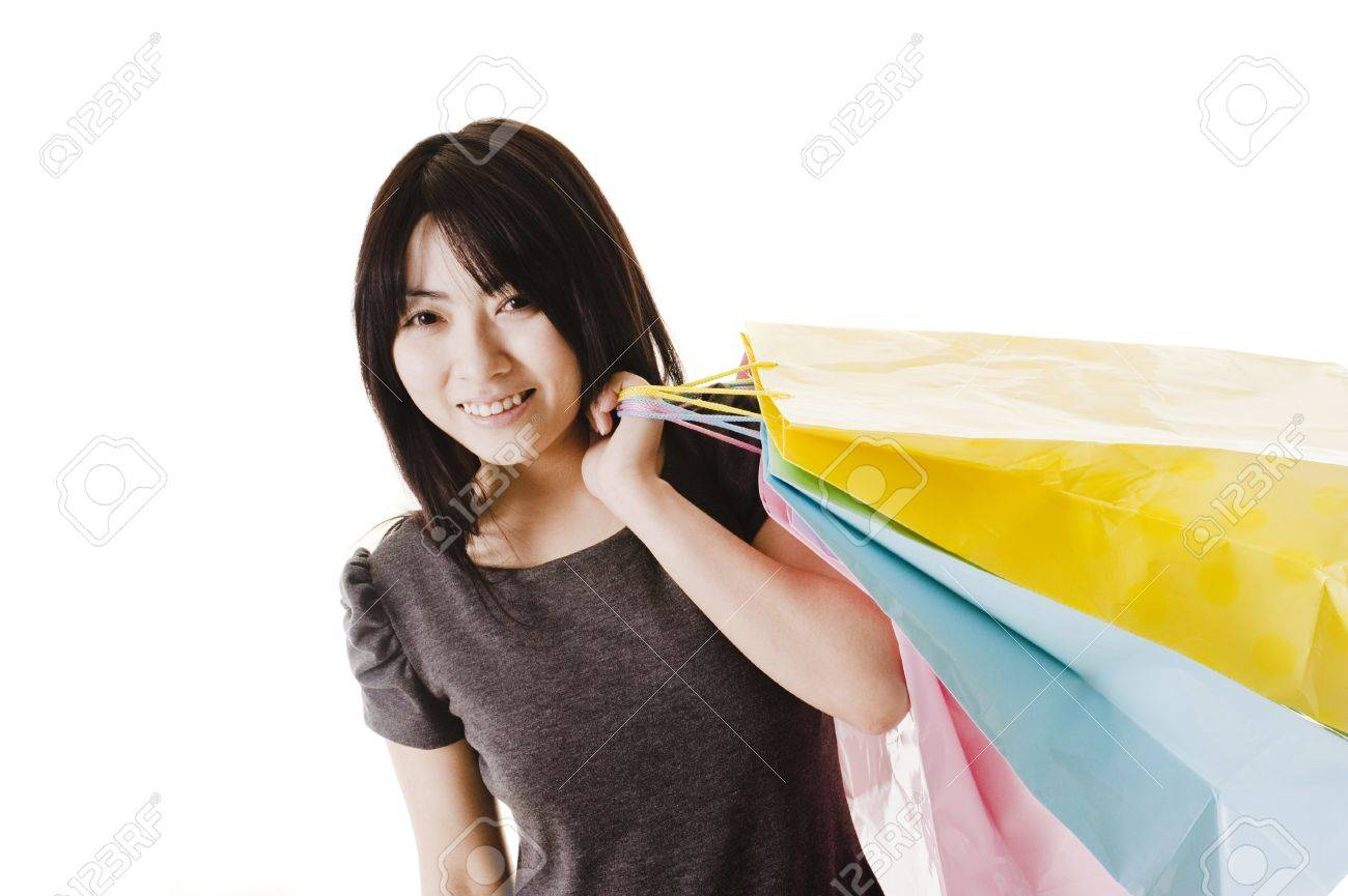 Beautiful Chinese woman with shopping bags in front of a white background. Stock Photo - 11261442