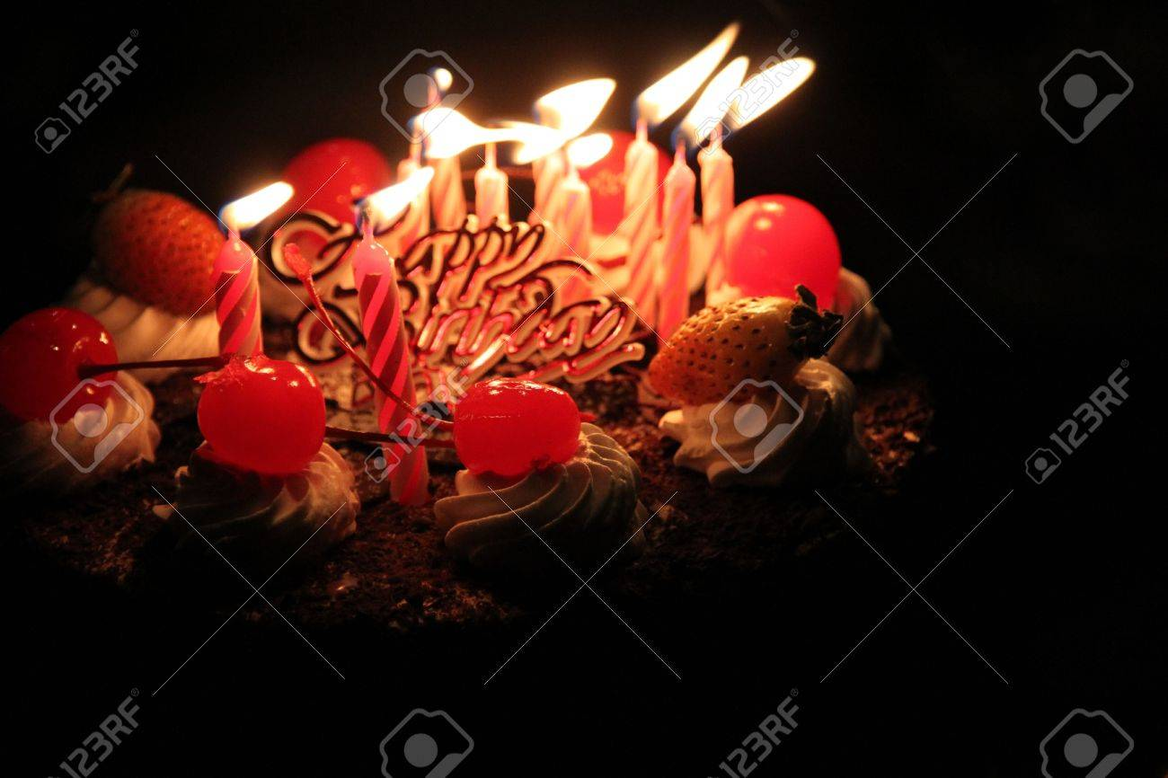 Birthday cake with lighting candles Stock Photo - 5779897
