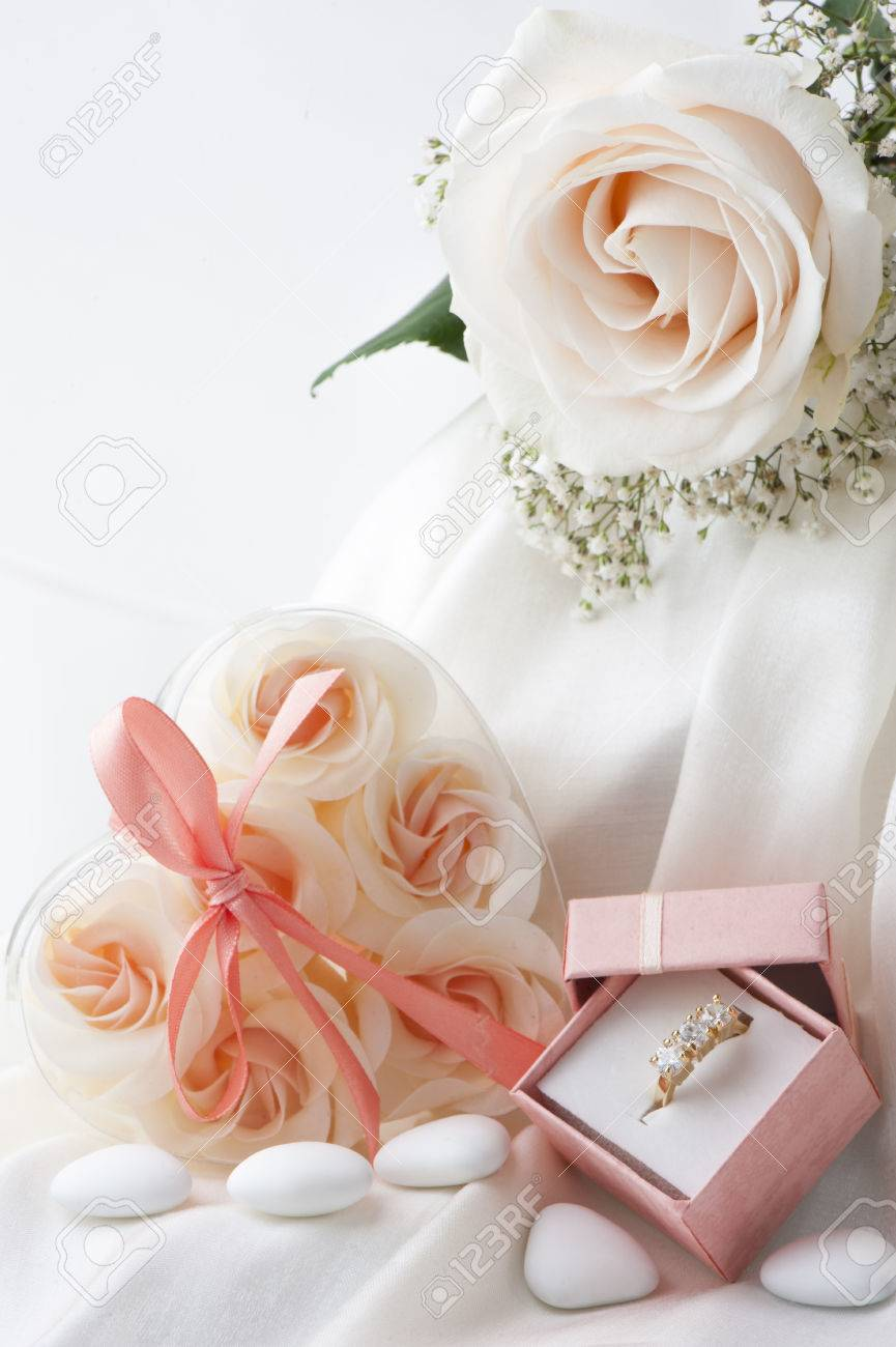 Wedding Favors,wedding Rings And Flowers On White Background Stock ...