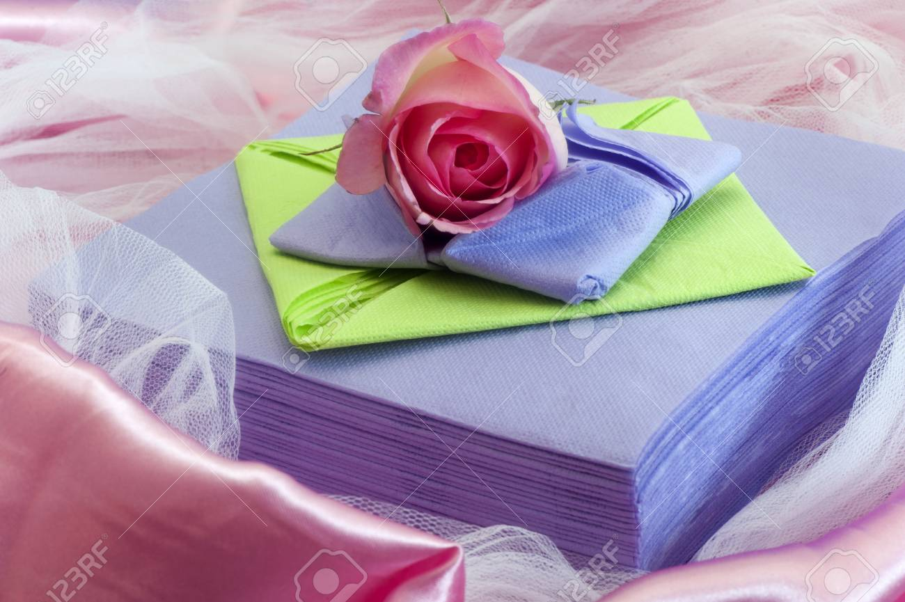 Elegant Origami Napkins To Decorate The Table On Fabric Background