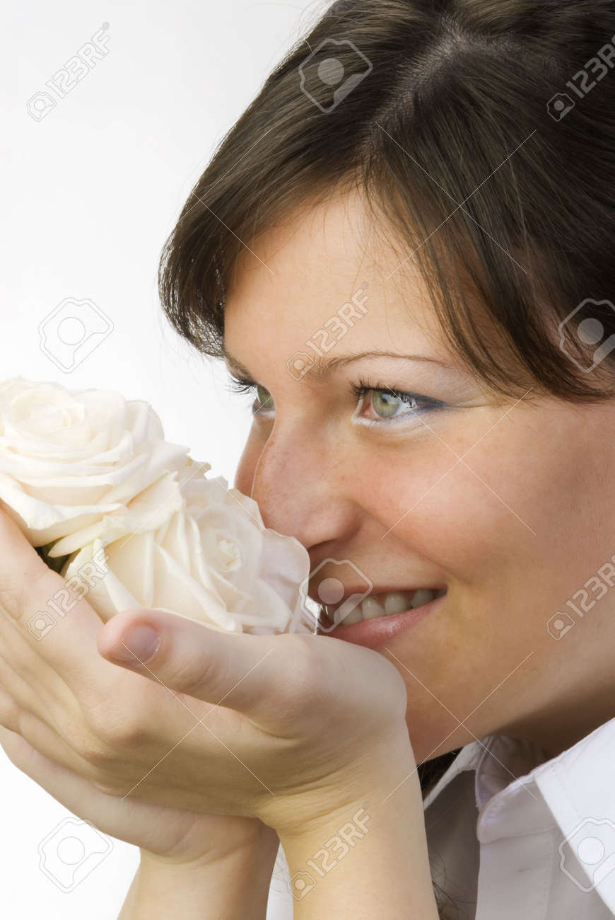 nice and young woman with roses in her hands smelling and smiling with her fair eyes Stock Photo - 958315