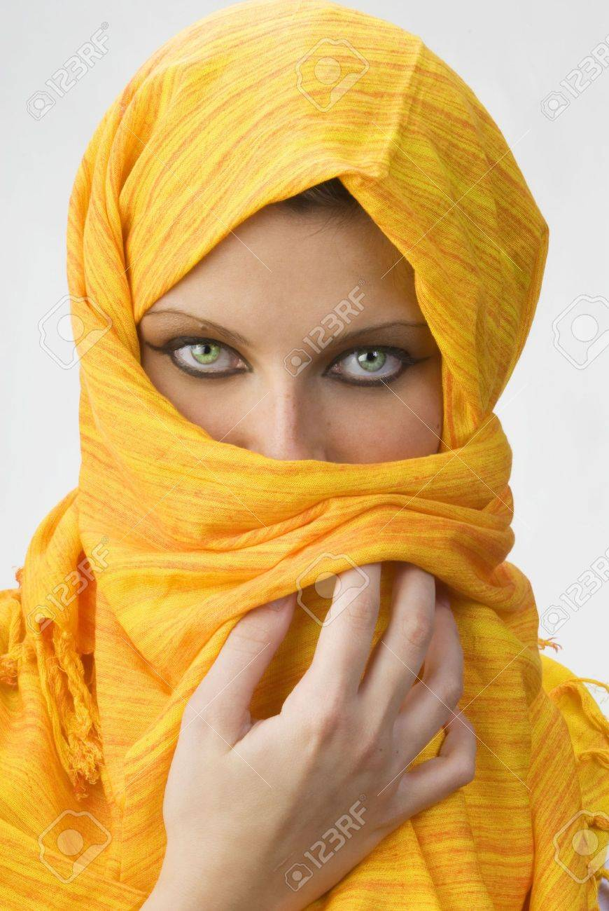 attactive and strong eyes behind an orange scarf used like a burka Stock Photo - 958375