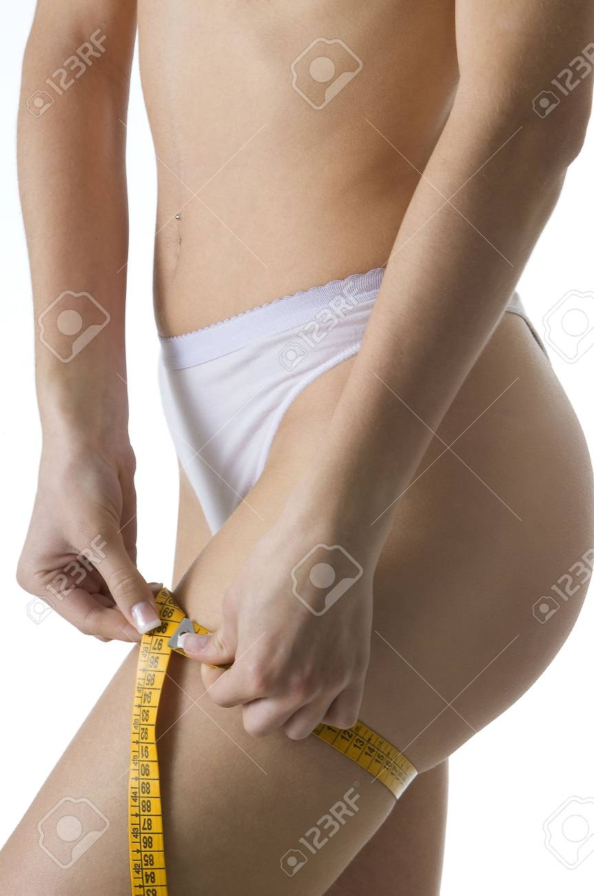 close up of a female body measuring her leg with a tape Stock Photo - 3083827