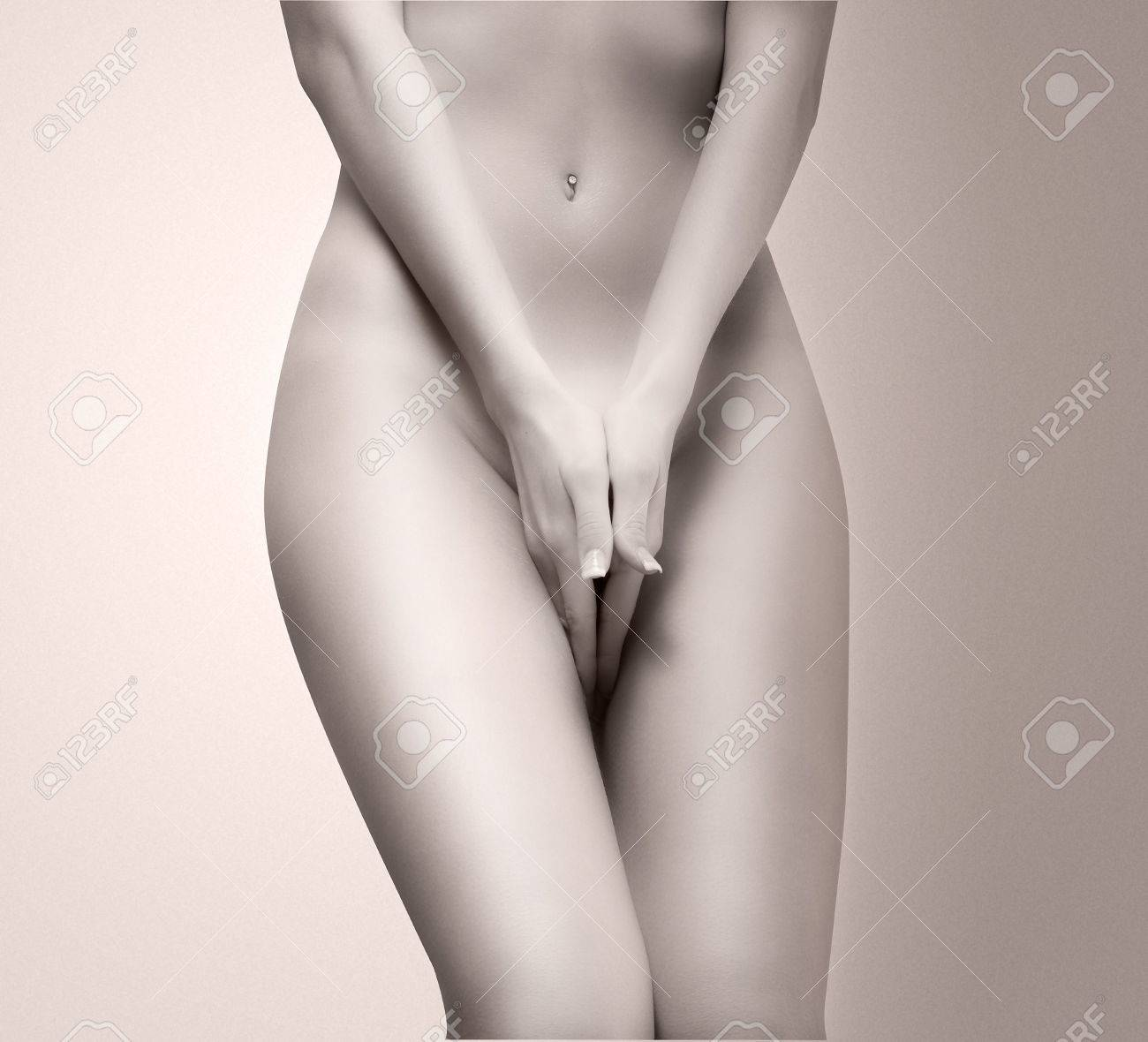 part of a nude woman body with close hands between the legs in a vintage photo Stock Photo - 3083840