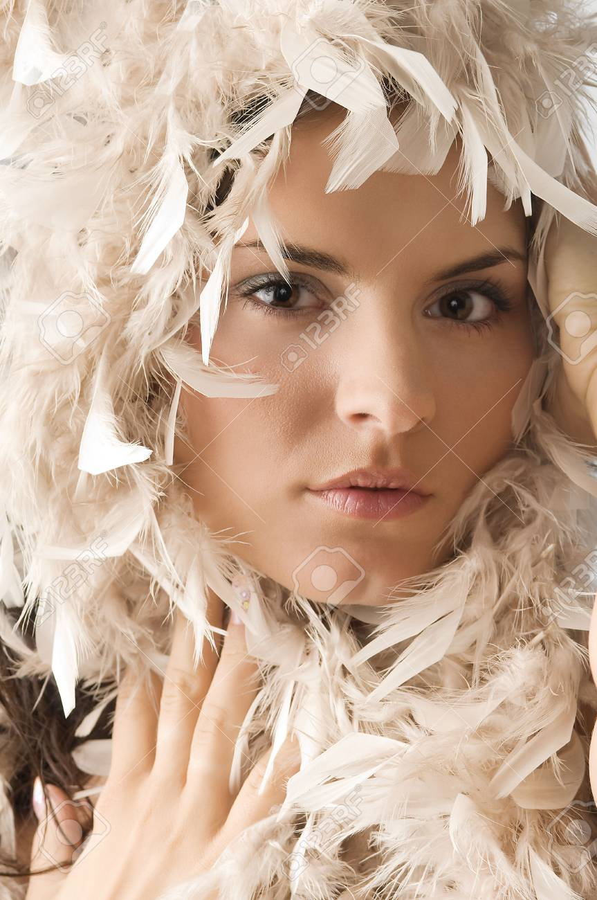 portrait of a cute young woman with feather around her face Stock Photo - 3304344