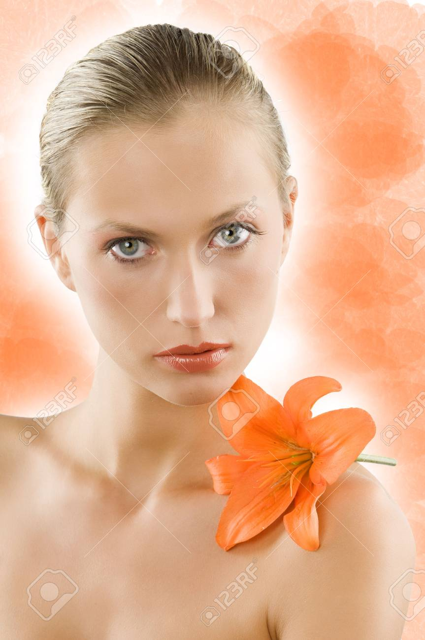great portrait of a blond girl with wet hair and an orange lily on her shoulder Stock Photo - 3558148