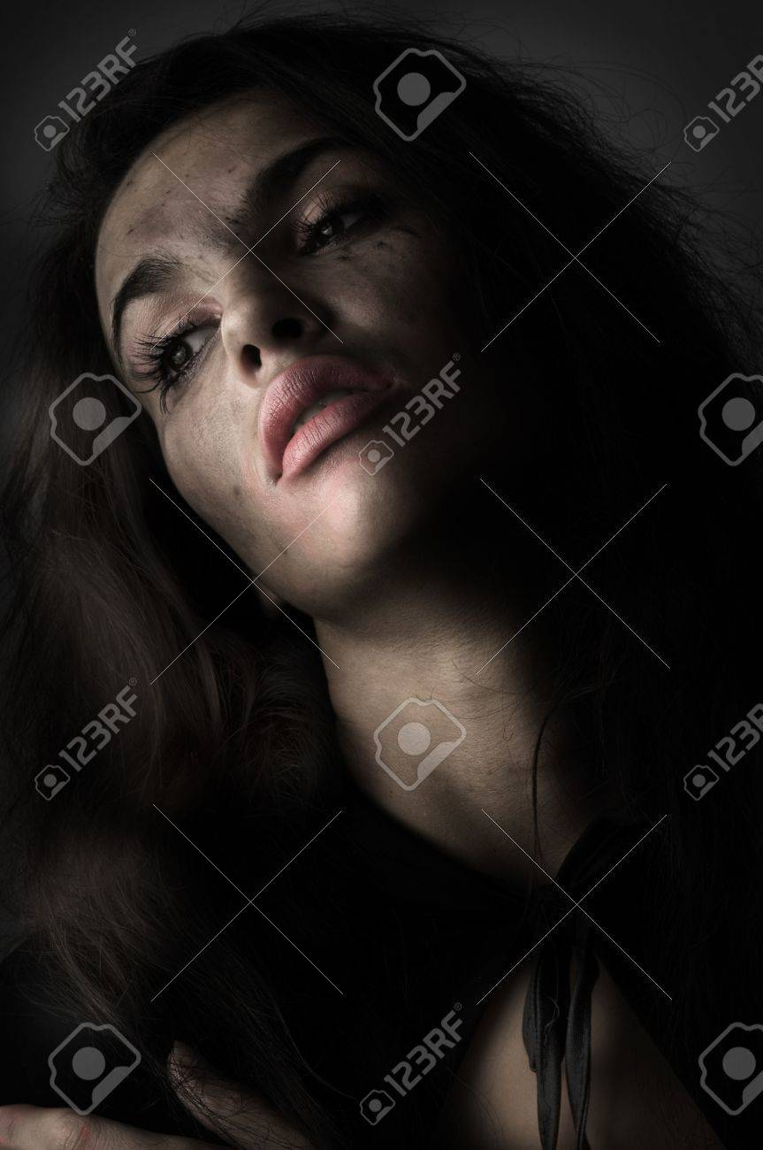 brunette in panic with broken make up in a desaturated portrait Stock Photo - 3689589