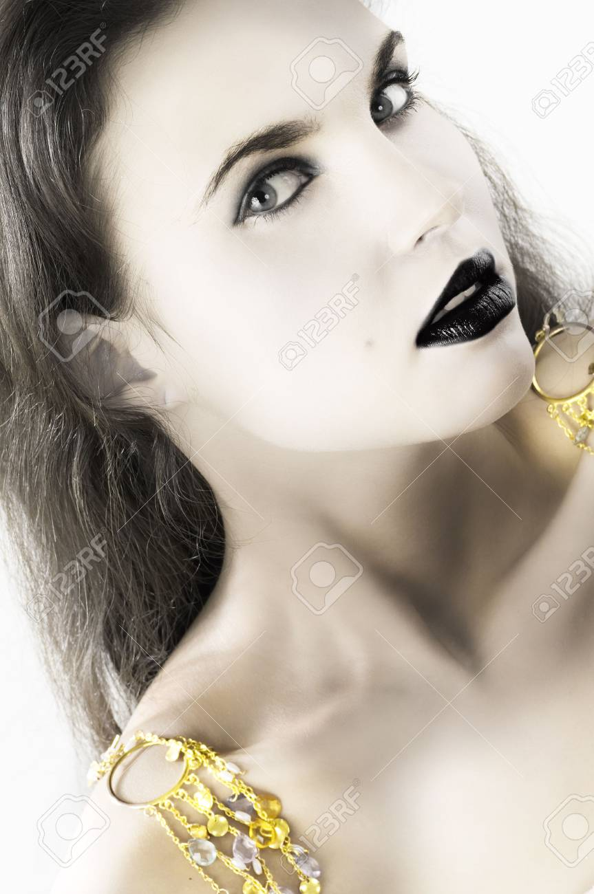sensual brunette with golden earrings on shoulder Stock Photo - 4006878