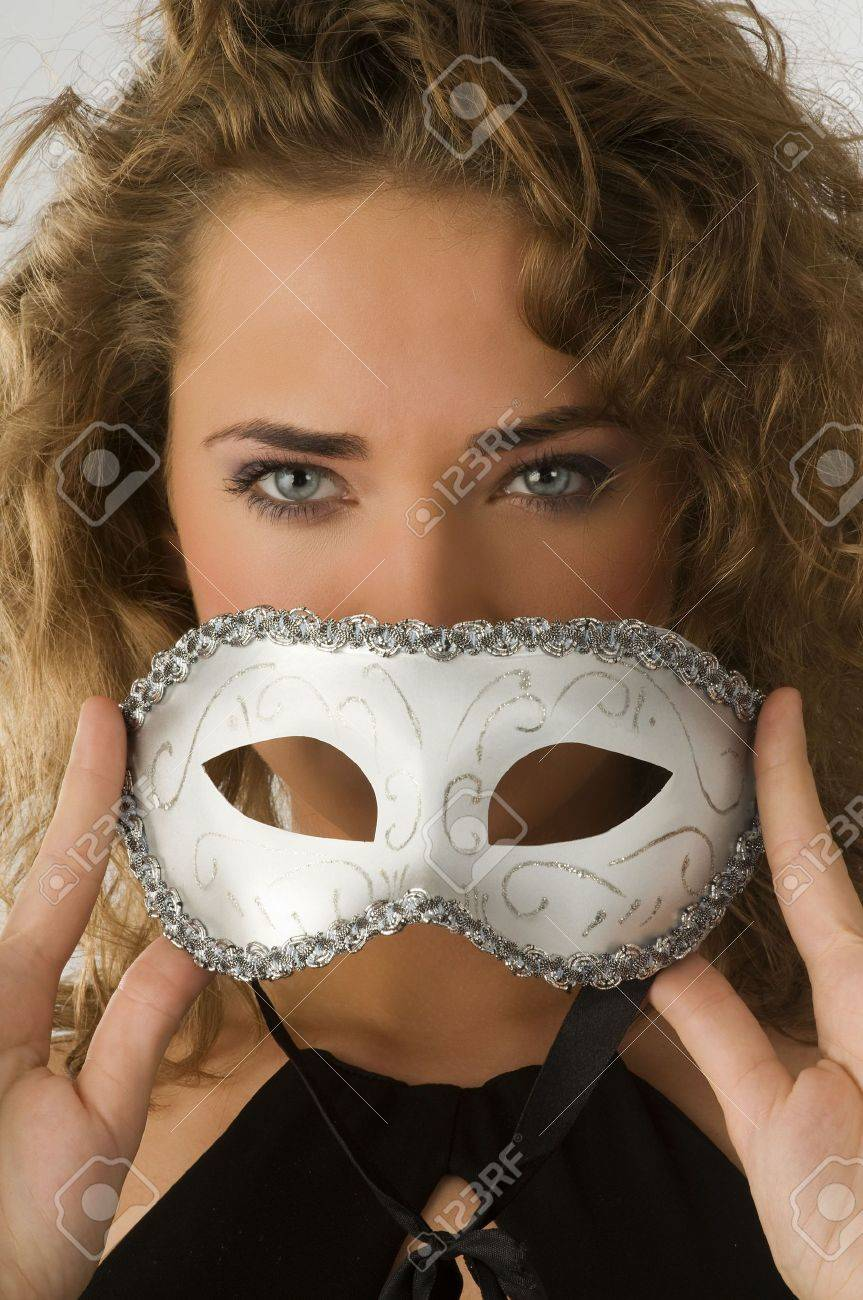 portrait of girl with face behind carnival mask with blue stunning eyes Stock Photo - 4205628