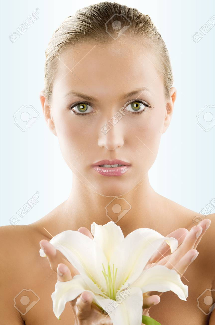 fresh portrait of a young and beautiful woman with a white lily and wet hair Stock Photo - 4480399
