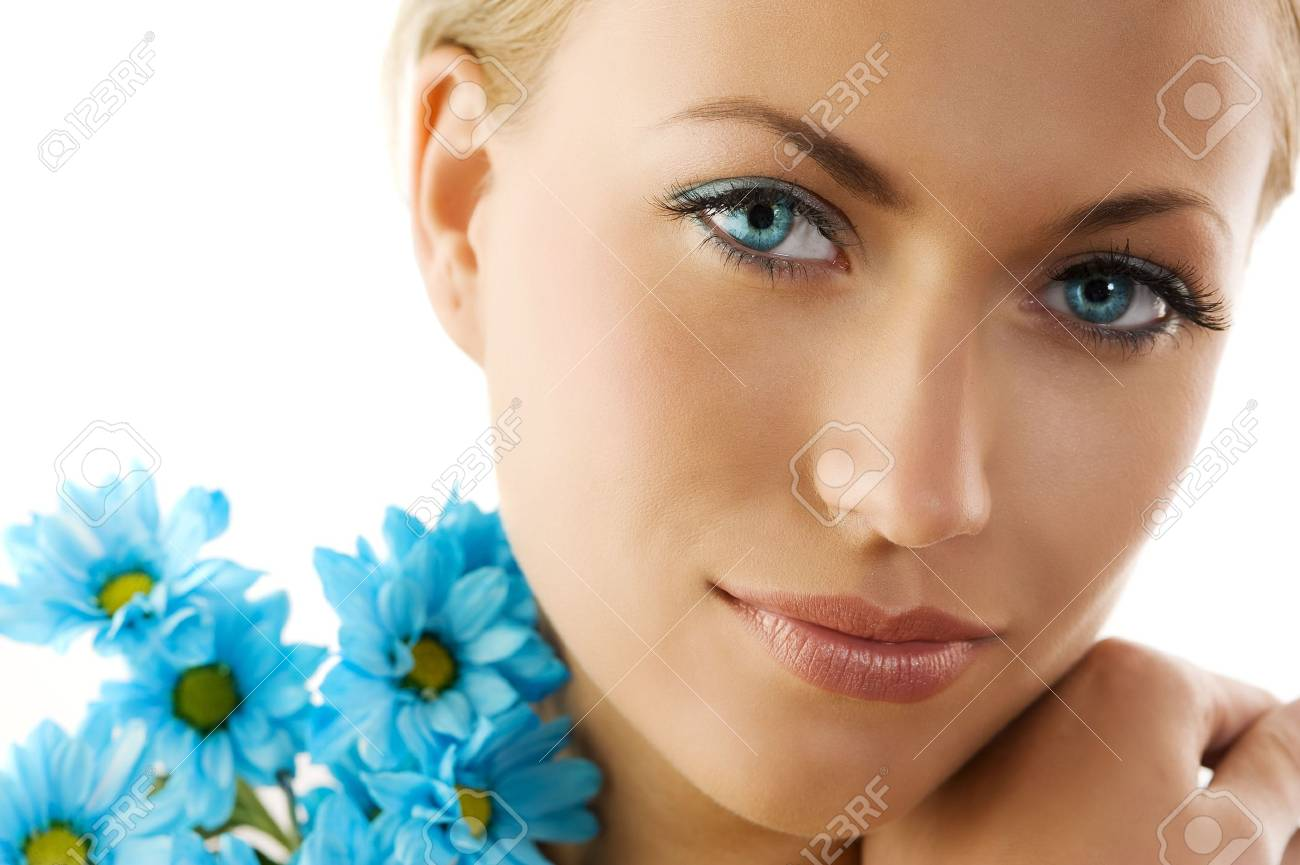 close up of a cute woman with big eyes and blue daisy Stock Photo - 5204944