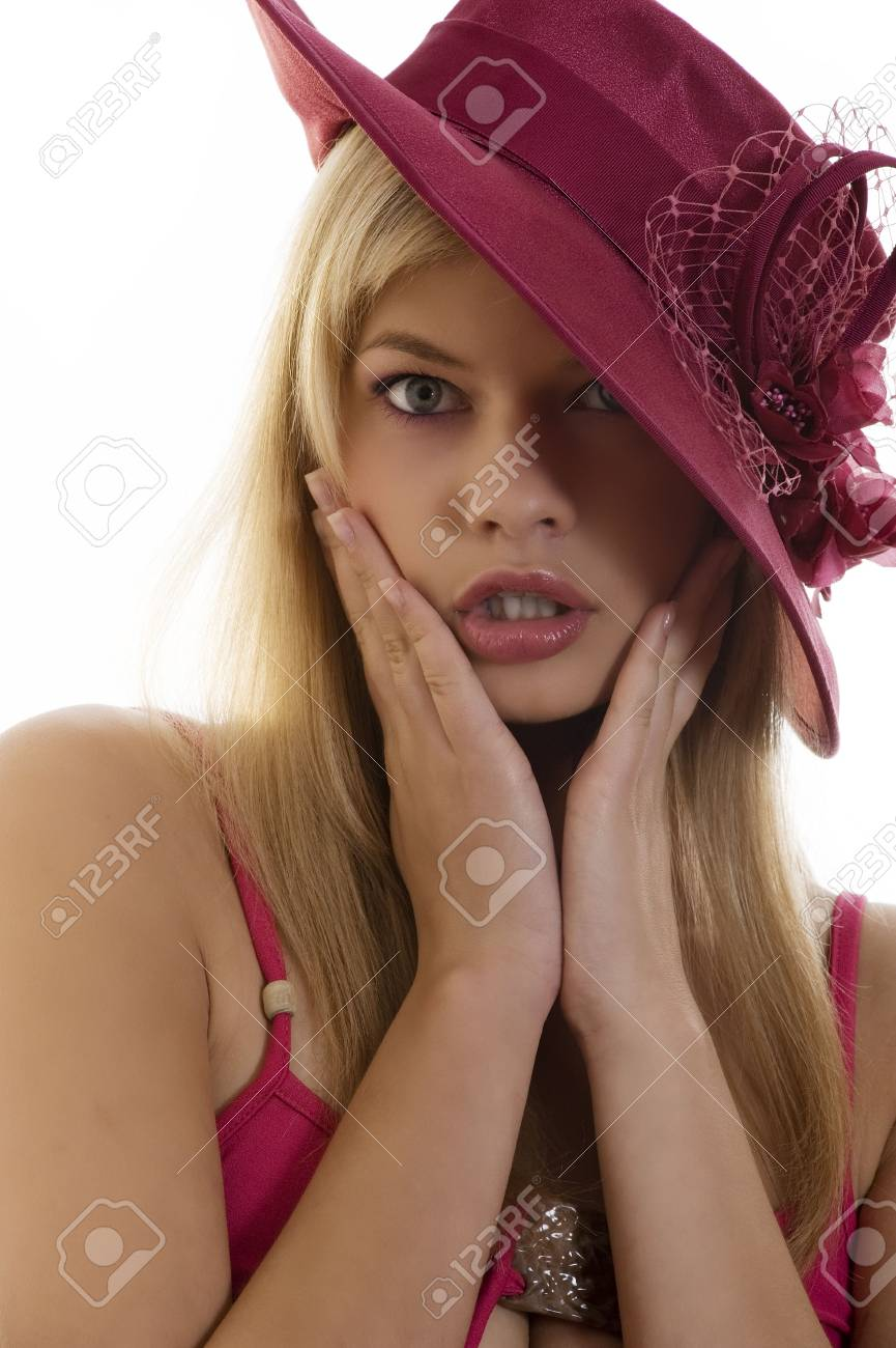 pretty blond woman with a red hat with hand near face in act to be surprised Stock Photo - 5677107