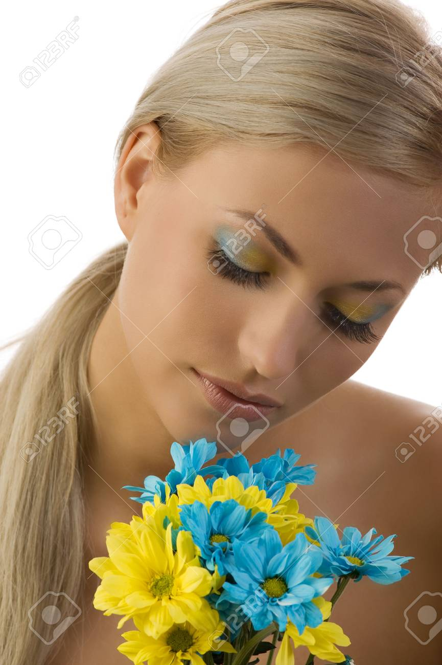 cute girl with colored flowers and closed eyes with yellow and blue make up Stock Photo - 5288603