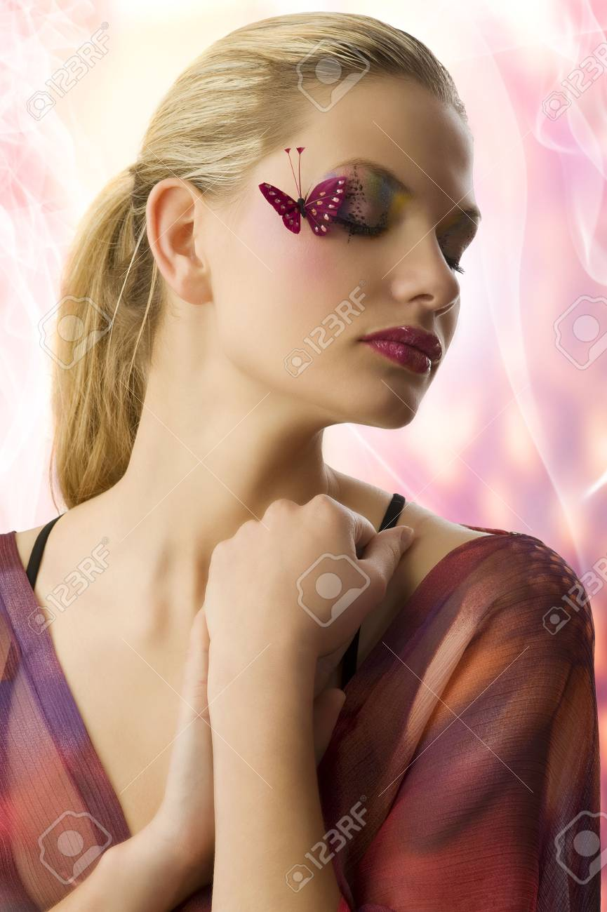 Beautiful woman in fashionable dress with creative makeup with butterfly on her face and closed eyes Stock Photo - 5501480