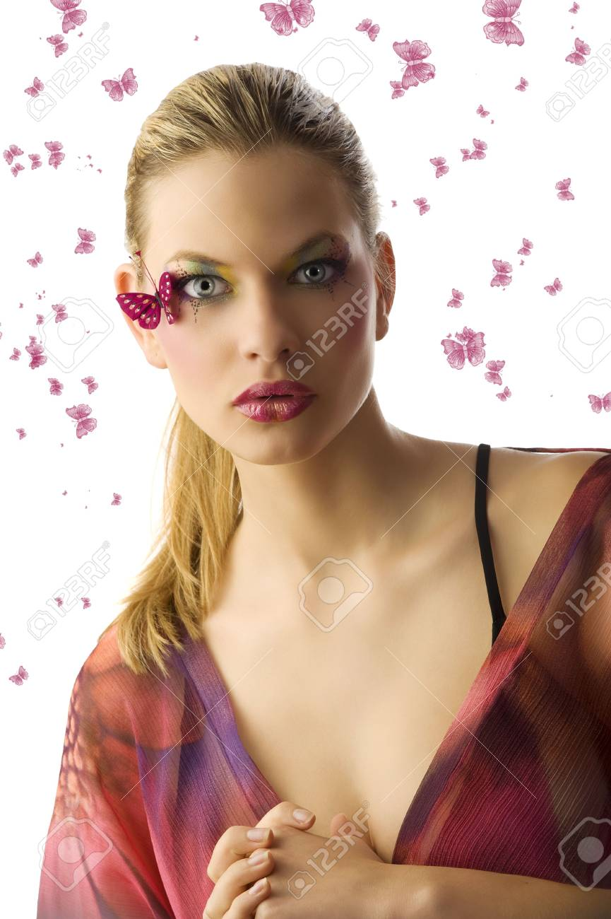 pretty blond woman  with creative makeup with butterfly on her face looking in camera surprised Stock Photo - 5501488