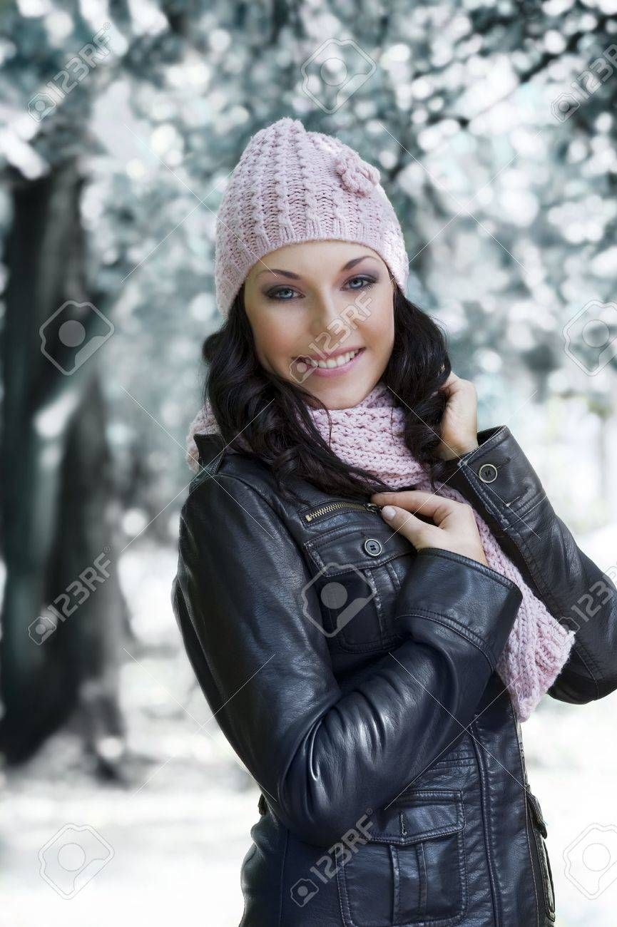 Nice Girl In Winter Dress With Leather Jacket And Pink Scarf Stock