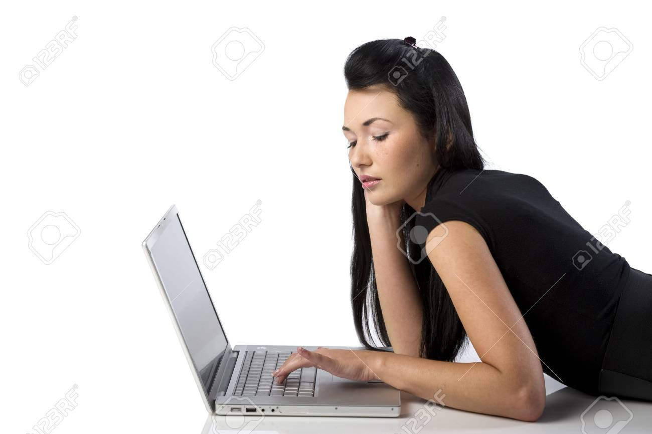 beautiful young oriental woman using a laptop laying down on the floor Stock Photo - 6164838