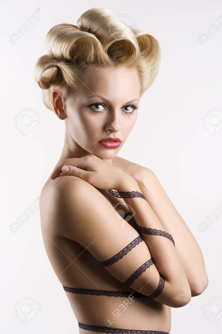 attractive blond girl with a fashion hair stylish and a strip lace around her naked body Stock Photo - 6553781