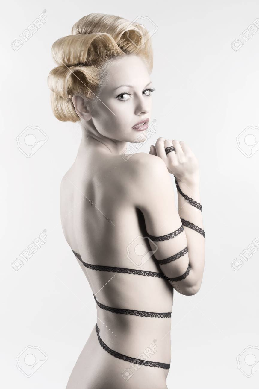 attractive blond girl with a fashion hair stylish and a strip lace around her naked body looking in camera Stock Photo - 6553786