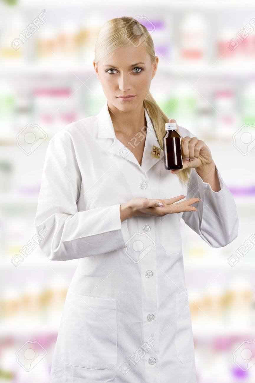 young blond woman as a nurse showing a madicine Stock Photo - 7174530