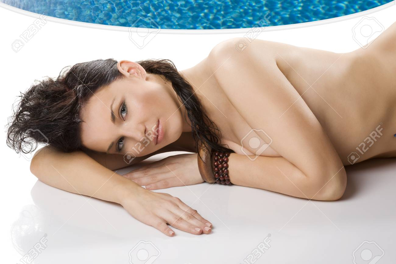 beauty shot of gorgeous and sensual brunette with ethnic accessory laying down on floor Stock Photo - 7514306