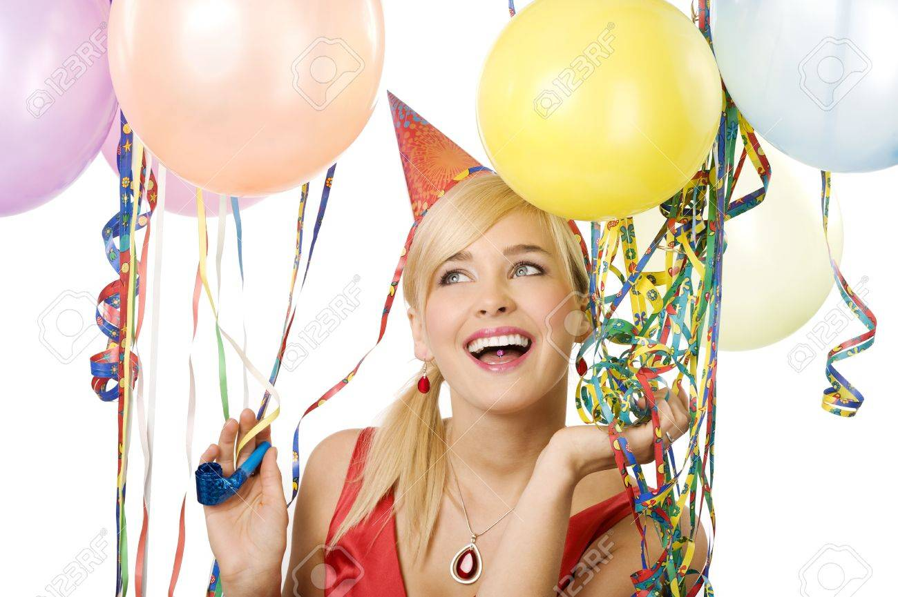 Pretty blond woman with funny hat and balloons during a party over white smiling and looking up Stock Photo - 8432707