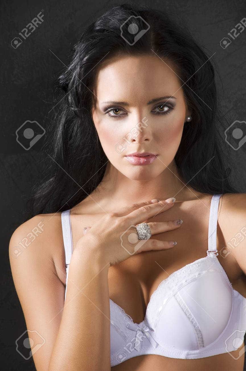 beauty portrait of young pretty brunette with white bra against a dark background looking in camera Stock Photo - 8753548