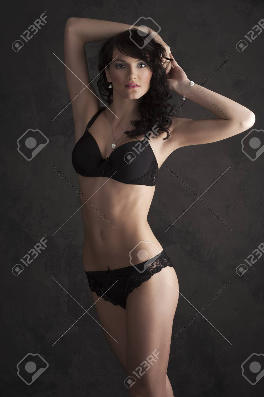 Glamorous sexy standing woman in black lingerie on dark background Stock Photo - 9150608