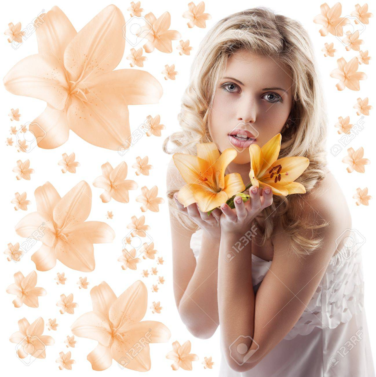 classic beauty portrait of young and beautiful woman with orange lily and blond curly hair on white background Stock Photo - 10626629