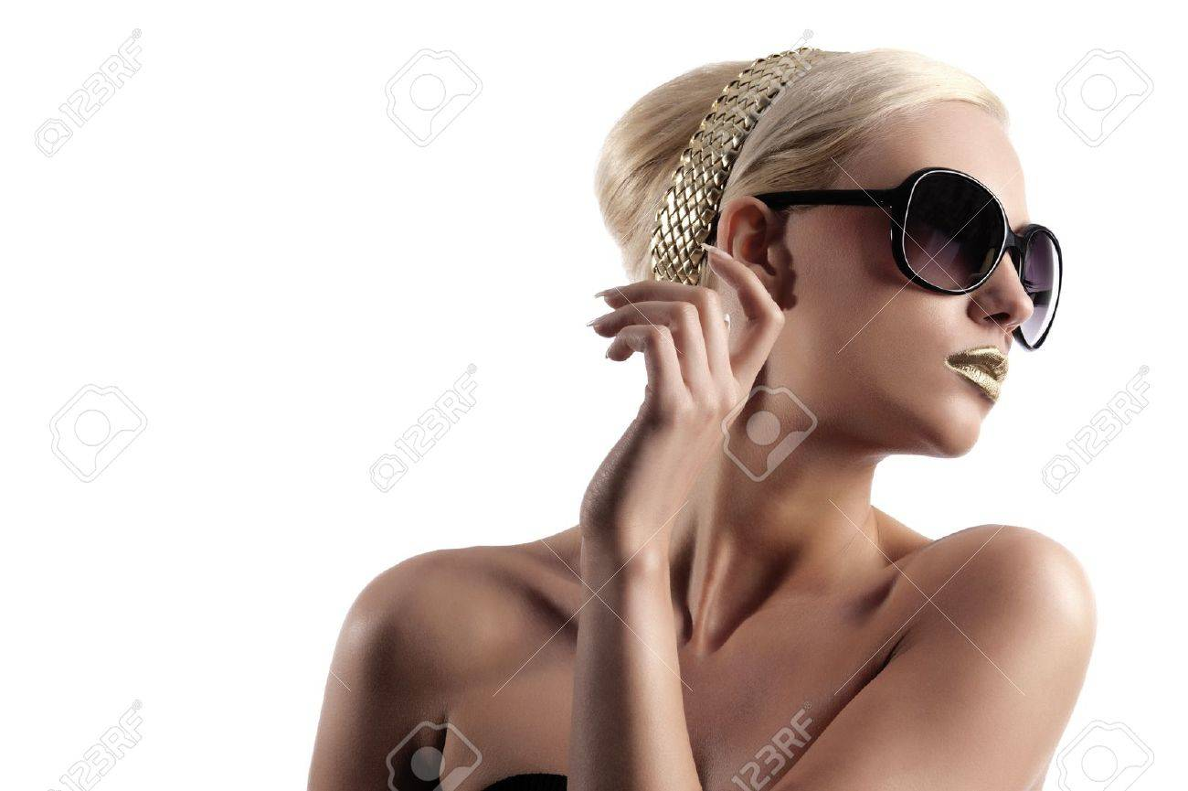 fashion portrait of young blond woman with hair style gold lips looking in one side with sun glasses Stock Photo - 10626665