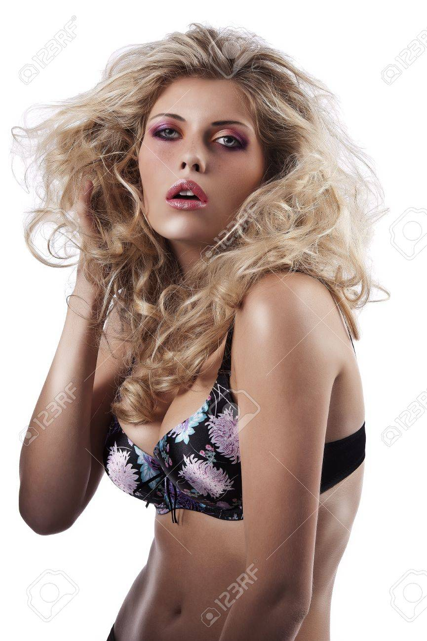 3966bccd14 beautiful curly blonde girl posing in colored bra on white Stock Photo -  10651626