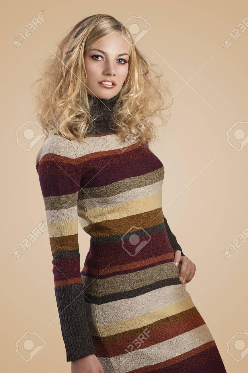 autumn fashion shot of a natural blonde beauty wearing a striped wool dress Stock Photo - 11086128