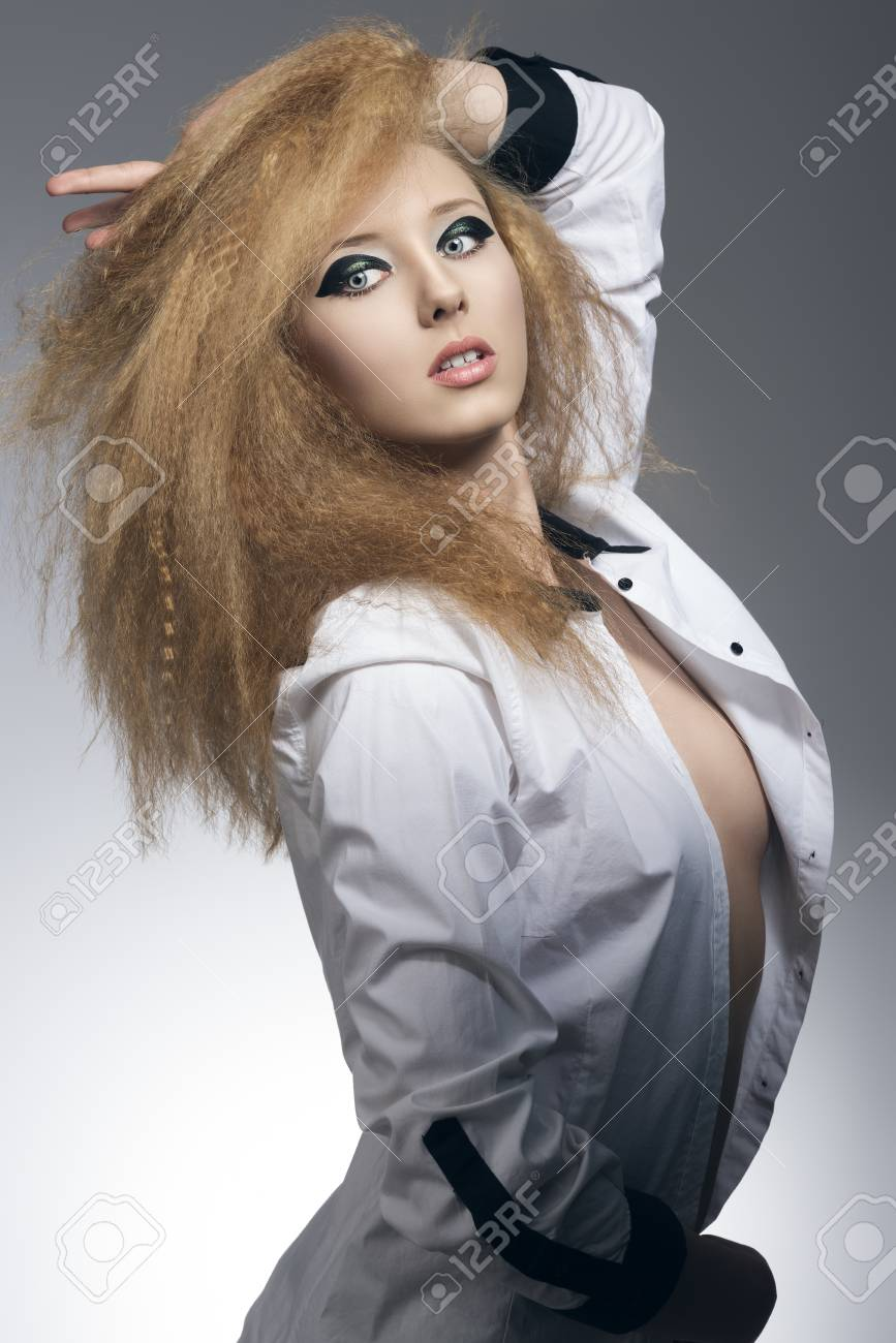 e6e77260fa cute blonde girl in fashion pose on gray background with rock style