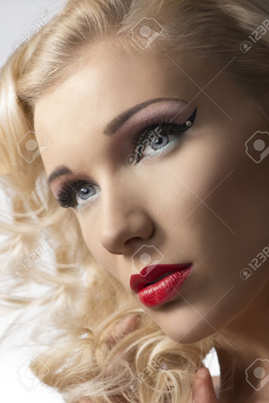 close-up portrait of beautiful woman with blonde wavy hair, cute make-up