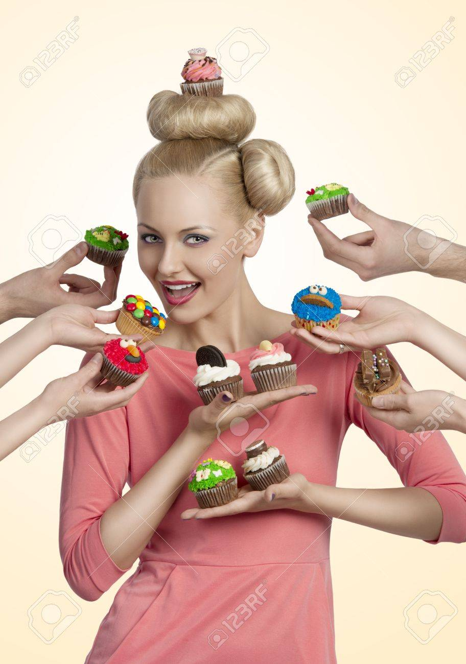 beauty blonde woman with cupcake on the head, some hands tendering other colorful cupcakes near her face Stock Photo - 20382986