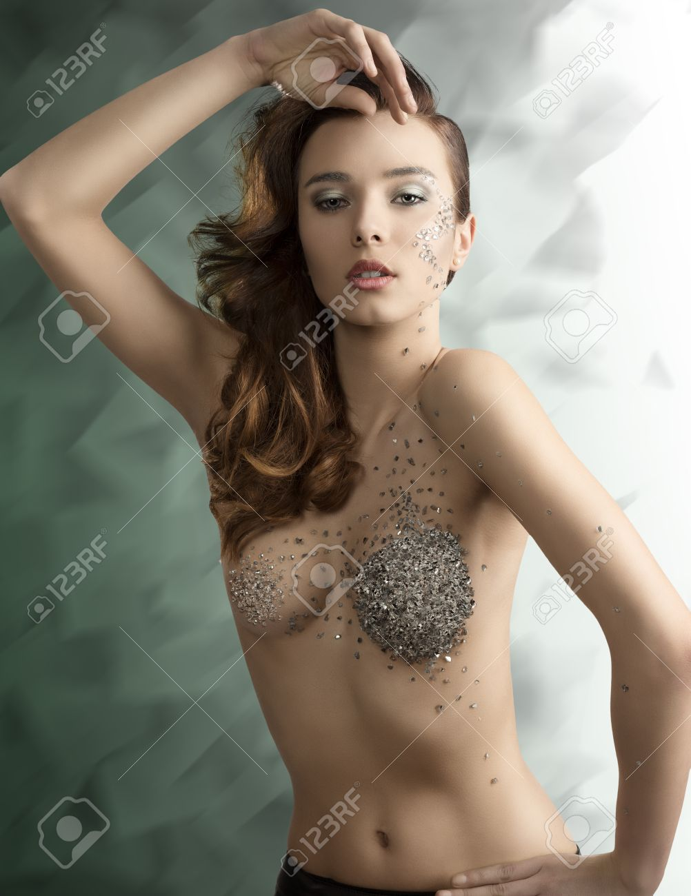 artistic portrait of naked brunette girl with fashion hair-style