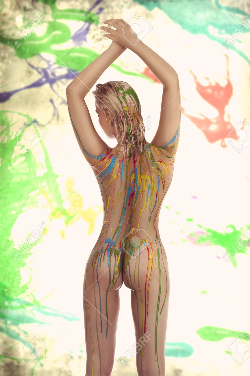 beautiful blond nude girl with multicolored body paint over her