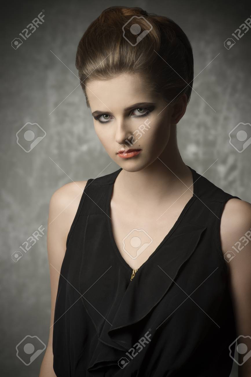 fashion portrait of very pretty young girl with creative elegant hair-style, cute make-up and stylish black dress Stock Photo - 30528261